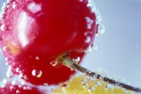 Rinsing A Fresh Cherry In Water