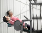 Woman Working Out On Exercise Machine