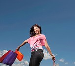 Low angle of young woman holding shopping bags, KwaZulu Natal Province, South Africa