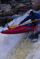 Close_up of a man canoeing in white water rapids