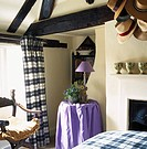 View of a bedroom under the attic with a purple corner table