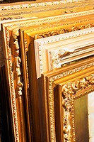 Close_up of an array of picture frames leaning against each other