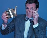 man holding up a teapot
