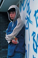 Young boy holding a spray paint can (thumbnail)