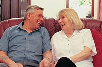 Elderly couple sitting on a couch (thumbnail)