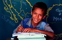 young boy studying at class