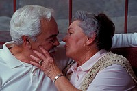 elderly couple about to kiss