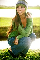 Hawaii, Kauai, Hanalei, Beautiful fashion model 0n a grassy field.
