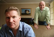 Portrait of gay man couple looking intensely at camera