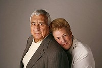Married senior couple posing for studio portrait
