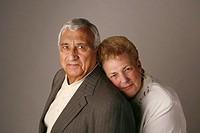 Married senior couple posing for studio portrait
