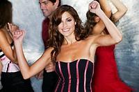 Glamorous woman dancing in nightclub