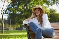Mixed race woman talking on cell phone outdoors
