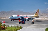 A Peruvian Airlines plane parked at the terminal in Arequipa, Peru, South America