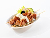 Fried pork kebabs with yoghurt sauce