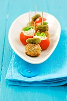 Meatballs with gherkins and tomatoes with soft cheese stuffing