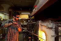 Detroit, Michigan - Paul Abowd heats glassware in a furnace at the Michigan Hot Glass Workshop