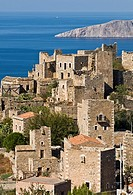 The stone tower houses the village of Vathia and the dramatic coast of the Deep Mani in the background, Southern peloponnese, Greece