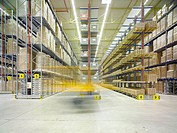 Forklift truck in a warehouse, blurred motion