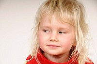 Stock photo of a blond haired four year old child looking to her right