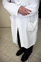 Hospital chaplain in white clothe