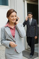 Business executives talking on mobile phones