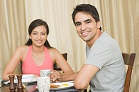 Couple having breakfast at a table
