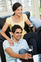 Couple drinking cold drink and smiling