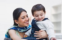 Close_up of a woman smiling with her son