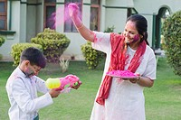 Woman playing Holi with her grandson