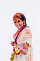Woman playing Holi with a pichkari