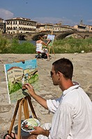 Art students paint by the Arno River, Florence, Tuscany, Italy