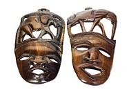 Close_up of two wooden masks