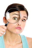 eye of a woman oversized through a magnifier glass