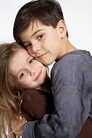 Older Brother Hugging Little Sister