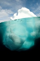 Antarctic peninsula iceberg Pleneau, split shot showing the large proportion of the berg that is underwater