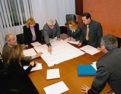 Elevated view of a business meeting around a conference table