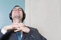 View of a business man wearing headphones