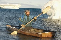 John Arnatsiaq, Inuit hunter paddling a kayak amongst pack ice  The kayak is used to retrieve seals that have been hunted from the water Igloolik or I...