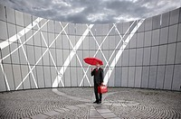 businessman with red suitcase and umbrella