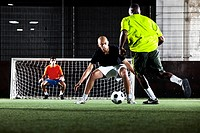 scene in street football match player defending goal