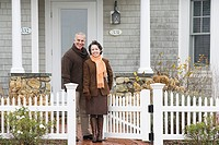 Mature couple outside house