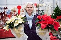 Woman with poinsettias