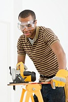 Man using electric saw