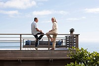Couple on balcony by the sea