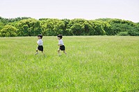 Twins Running in Park