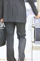 Businessman walking through ticket turnstile