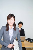 Office workers smiling in suits