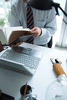 Man holding book in office