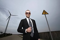 Businessman wearing sunglasses holding his suit